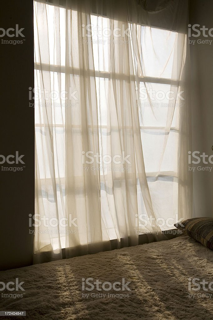 Window Light through Translucent Curtains stock photo
