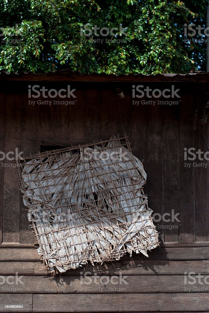 Window made of palm leaves stock photo