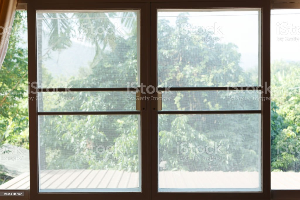 window mosquito wire screen plastic net protection from insect bug stock photo