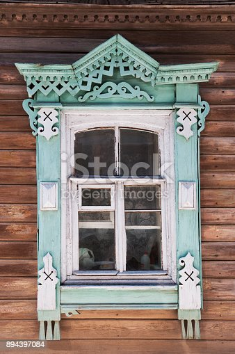 Window of an old Russian wooden house from the times of the old Russian Empire.    The city of Astrakhan (Southern part of Russia, the border of Europe and Asia, the Delta of the Volga River)