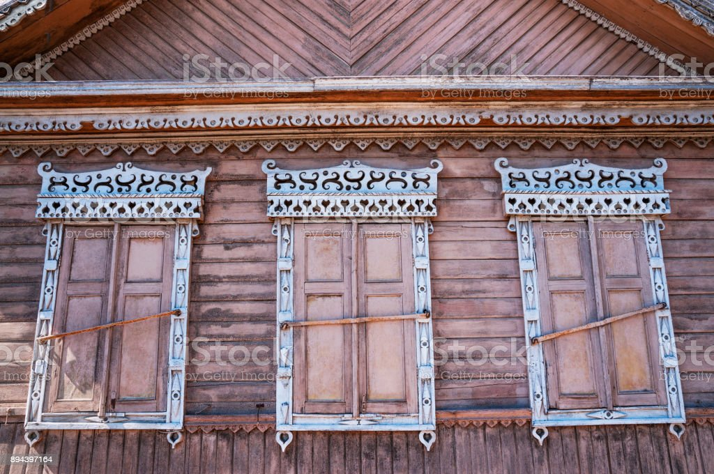 Window of an old Russian wooden house from the times of the old Russian Empire.