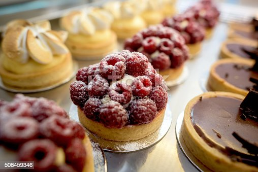 Window of delicious desserts at a pastry shop - food concepts