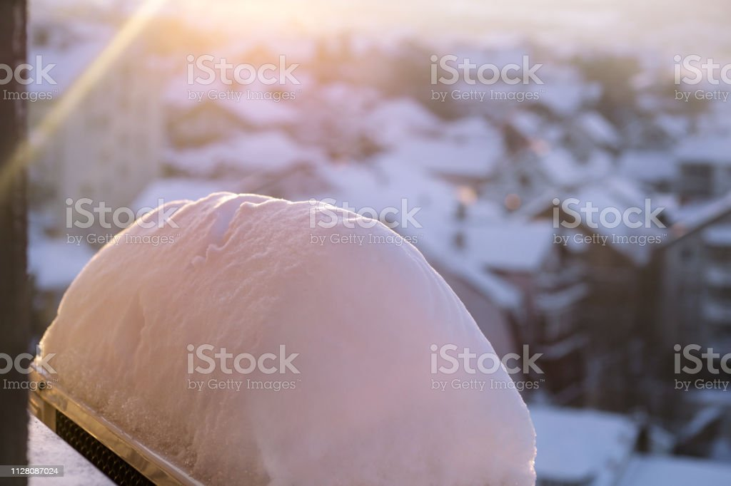 Window of home covered with big snow layer in winter, view from...