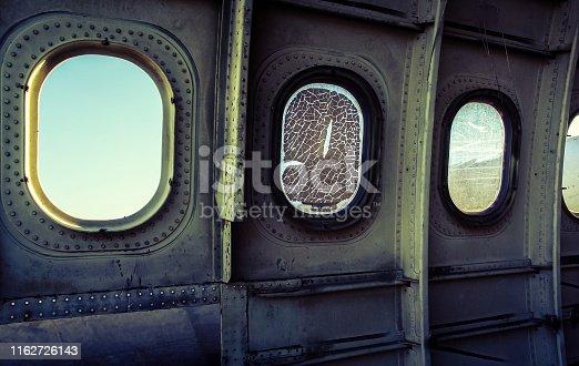 istock Window of plane wreck 1162726143