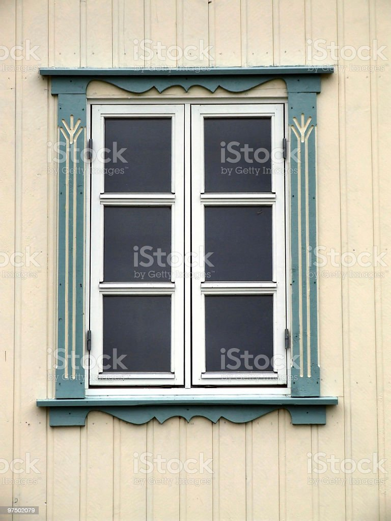 Window on a bright yellow wall royalty-free stock photo