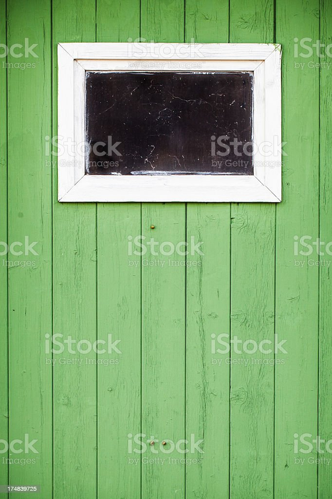 Window on green wall royalty-free stock photo