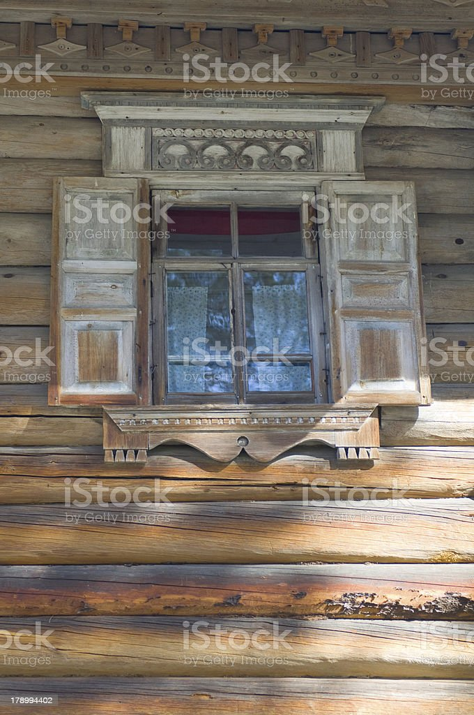 Window on old wooden house. stock photo
