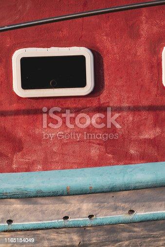 Detail of window, cabin and hull of an inshore fishing boat.  Nikiti, Sithonia, Greece.