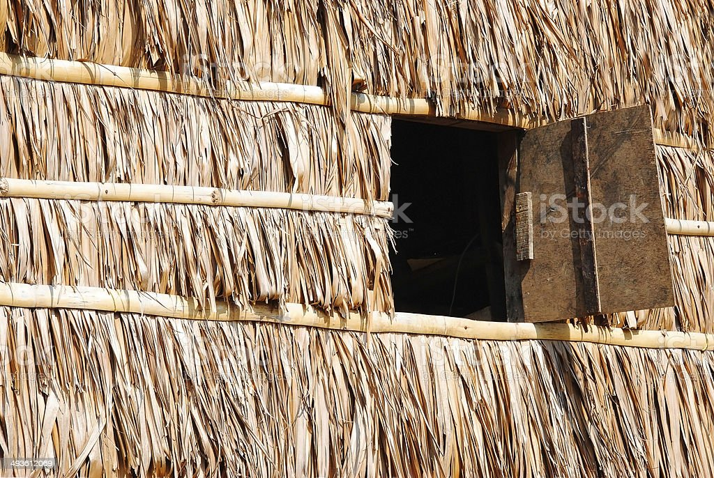 Window Panel On Thatch Wall royalty-free stock photo