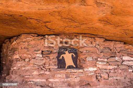 Composite image with a shaman petroglyph in the window of an ancient ruin. Southern Utah, American Southwest.