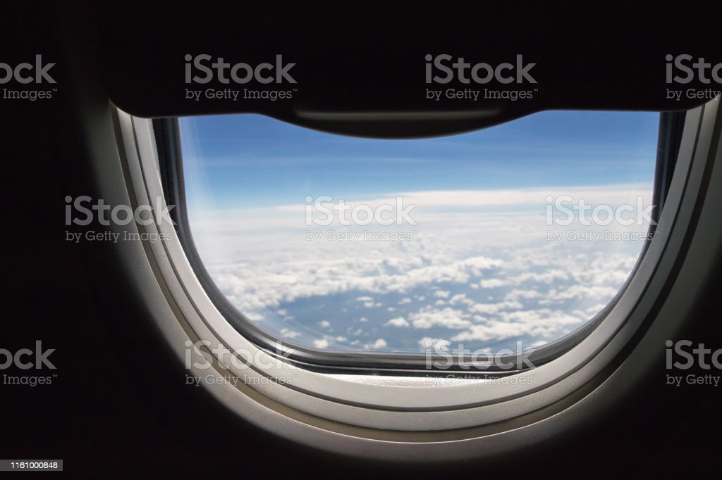 Window Seat An Open Halfspace In Airplane With Blue Sky And Clouds