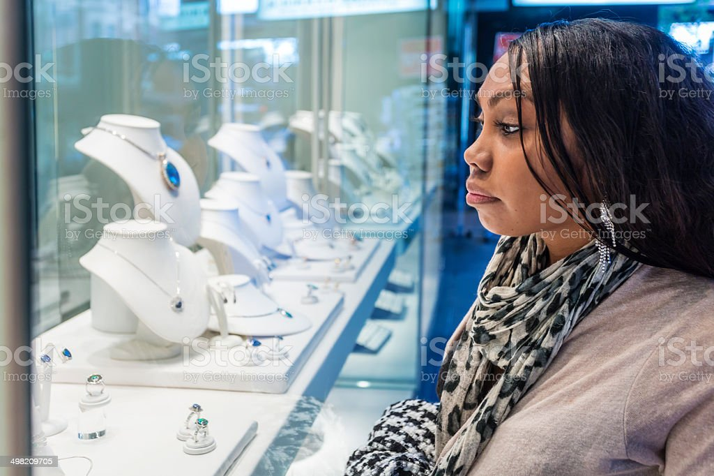 Window Shopping Aboriginal Woman royalty-free stock photo