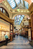 Melbourne, Australia - People in the old fashioned covered Block Arcade in Melbourne's city centre, where a variety of luxury and boutique shops are located.