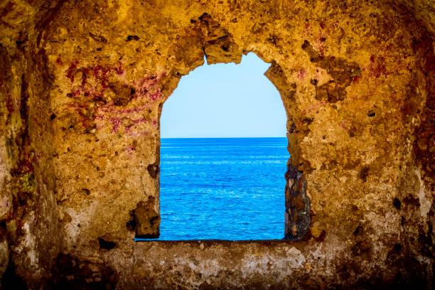 Window toward the ocean stock photo