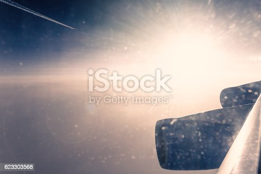 621114928istockphoto Window view at amazing clouds 623303568