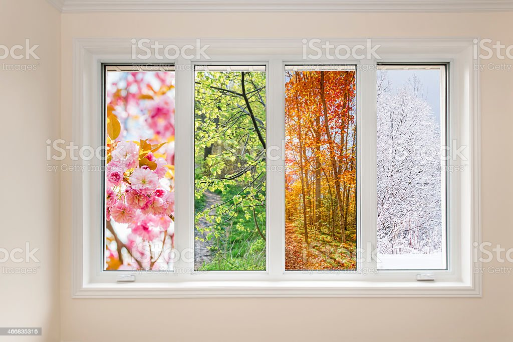 Window view of four seasons stock photo