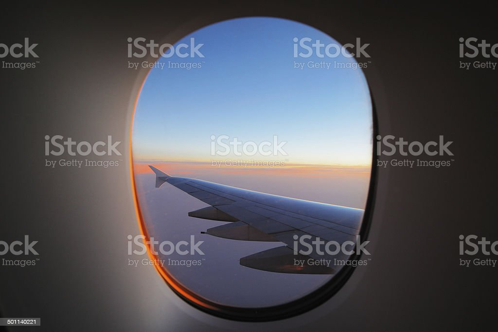 Window view of the wing at dawn stock photo
