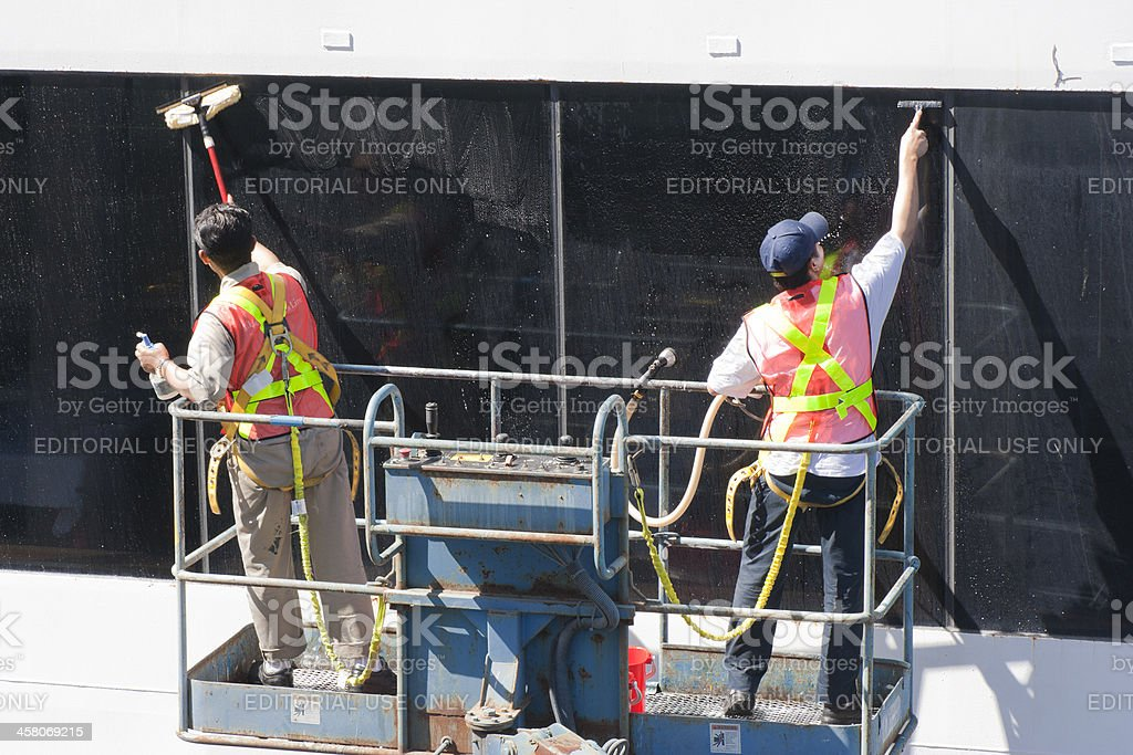 Window Washers cleaning the Windows of a Cruise Ship stock photo