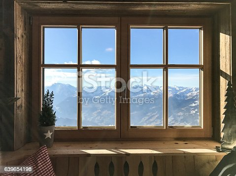 window with alps in background