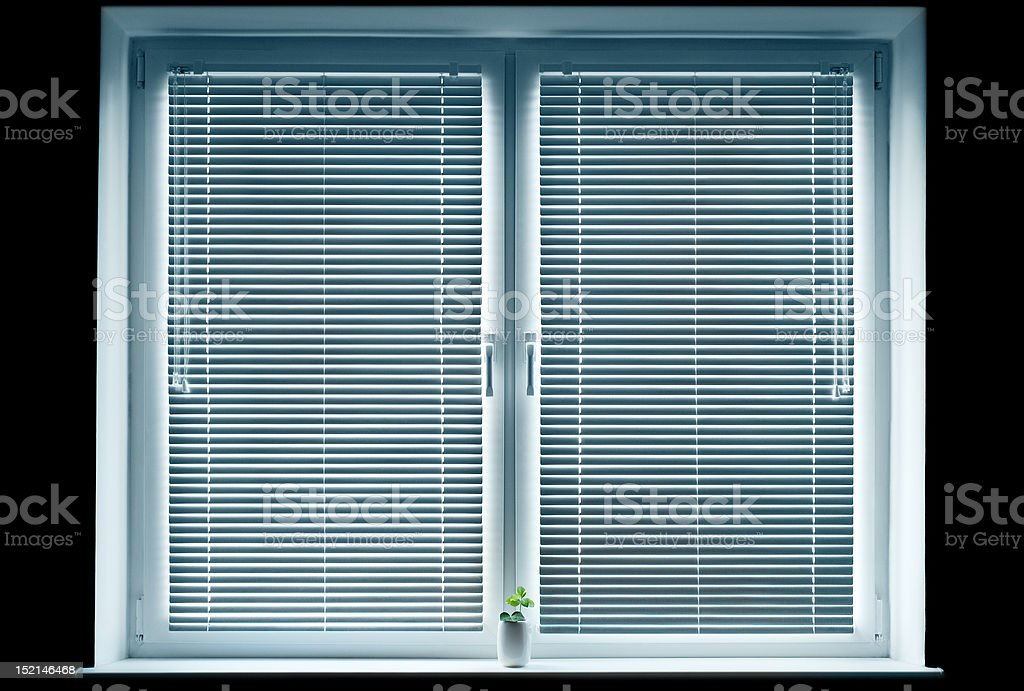 Window with blinds isolated on black. royalty-free stock photo