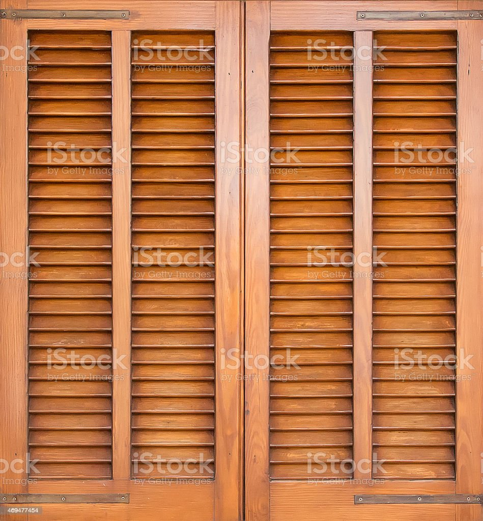 Window with brown shutters. Close-up view. stock photo