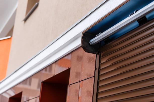 window with closed roller shutter closeup - com portada imagens e fotografias de stock