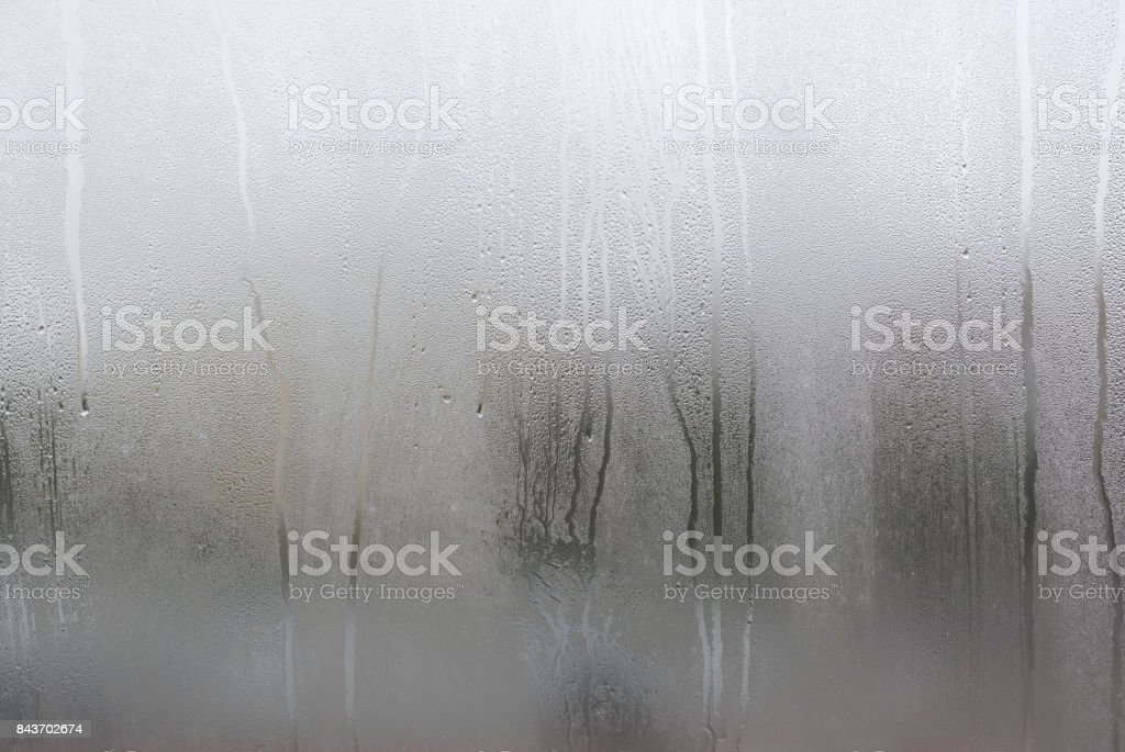 Window with condensate or steam after heavy rain, large texture or background stock photo