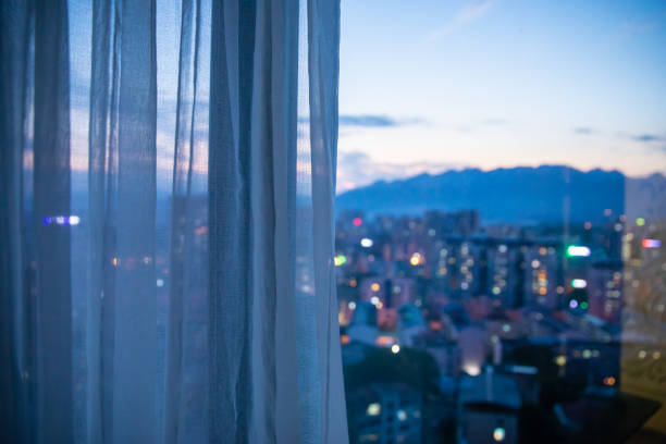 Window with curtain in the night stock photo