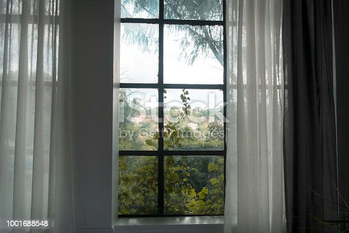 697868238 istock photo Window with curtain  Photos Window with curtain in the morning 1001688548
