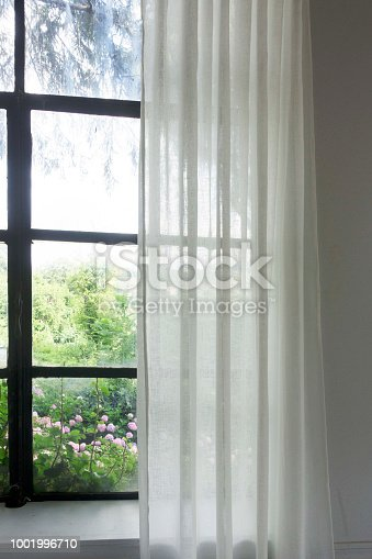 697868238 istock photo Window with curtain  Photos Window with curtain in the morning 1001996710