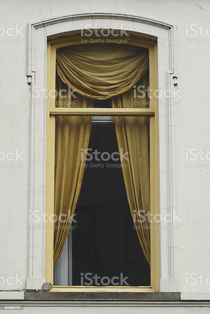 Window with gold fabric curtains royalty-free stock photo