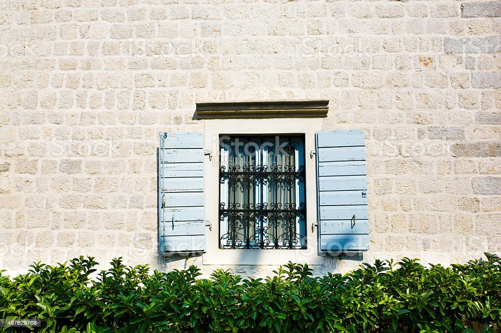 Window with Open Wooden Shutters. stock photo