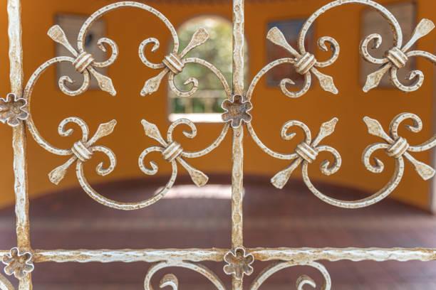 Window with ornate metal bars stock photo