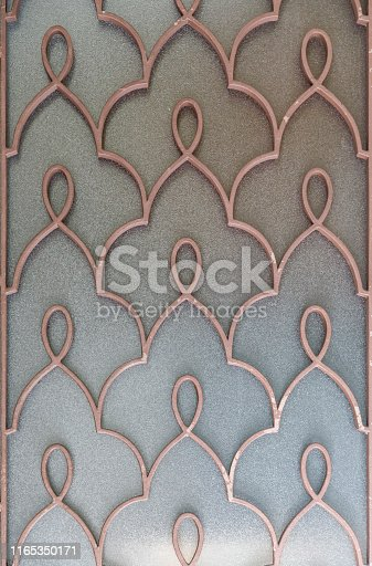Window close up shot with patterned ironwork fence