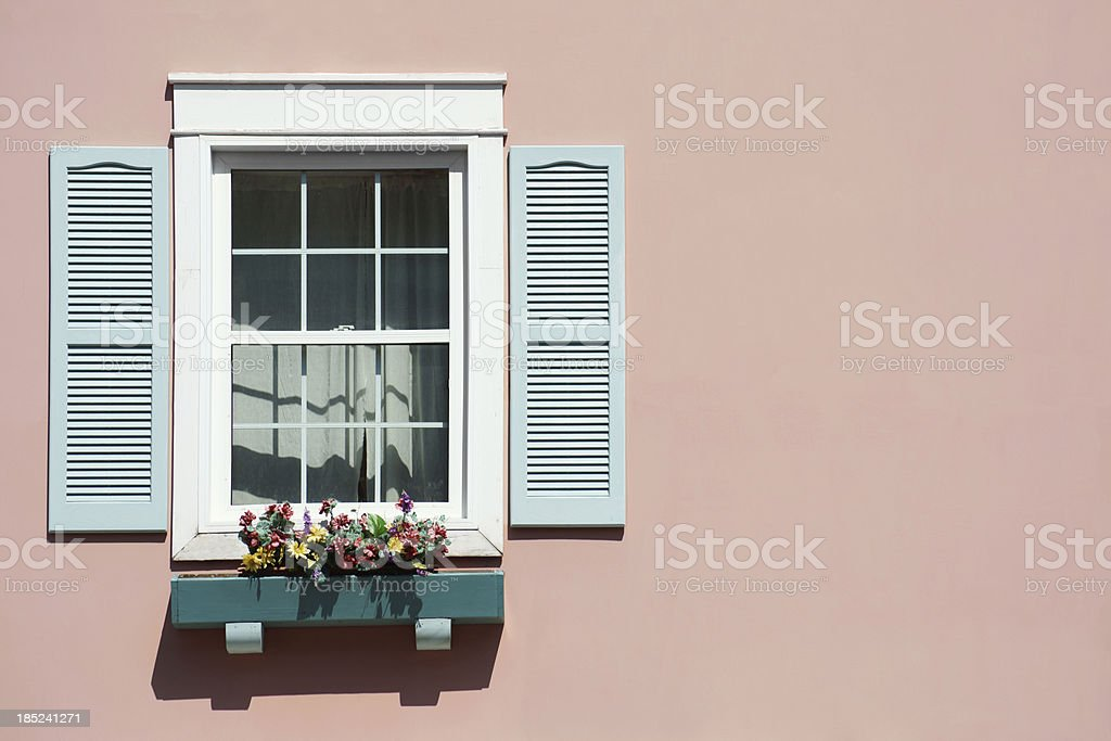 Window with pink background and windowbox. stock photo