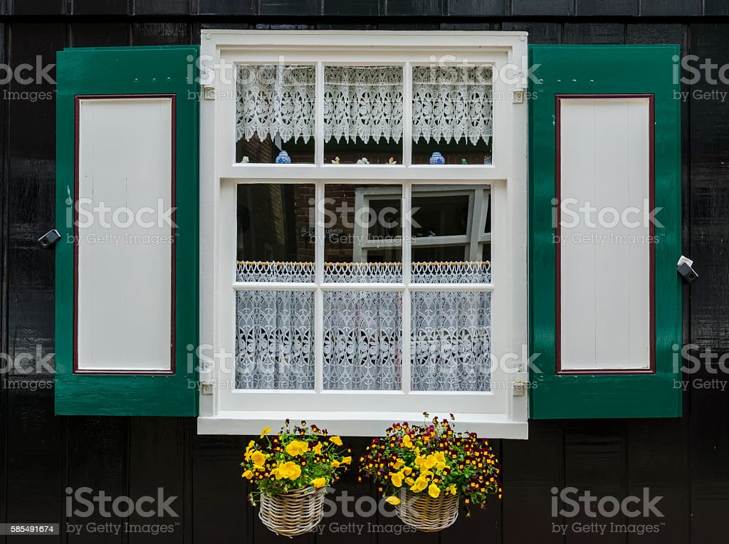 Window with shutters in Marken stock photo