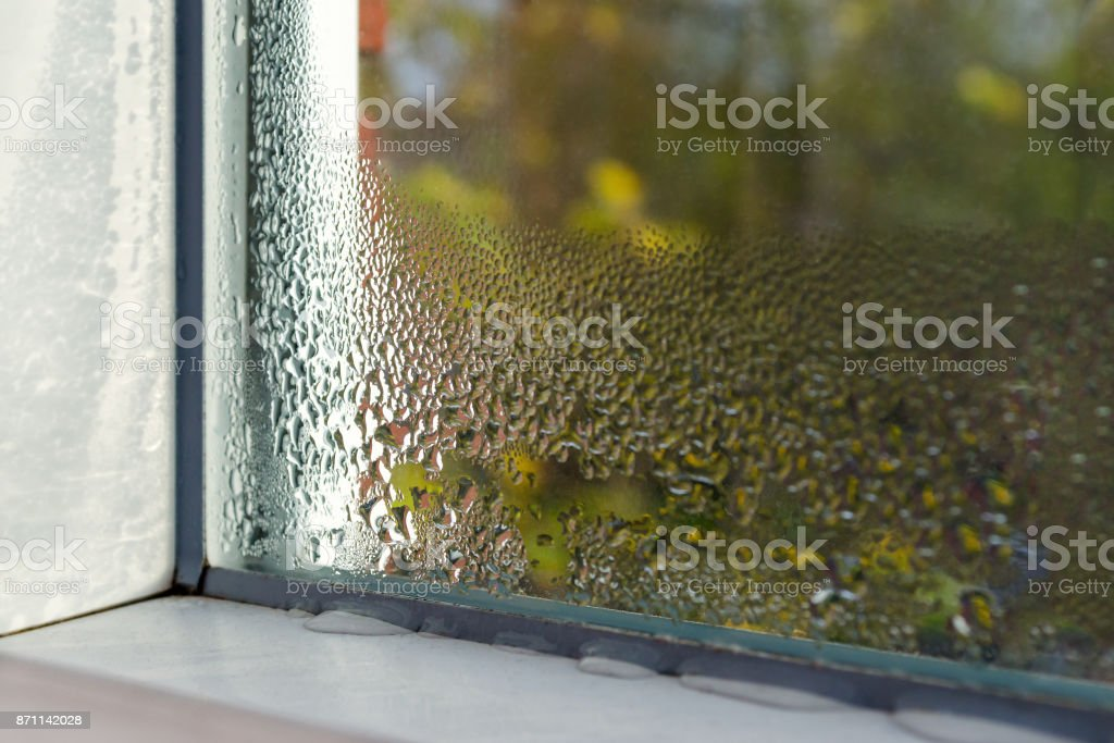 window with water drops closeup, inside, selective focus stock photo