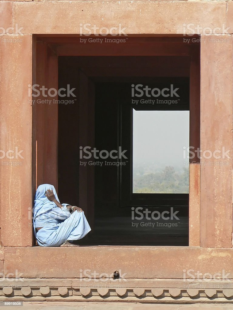 window with woman in blue sahri royalty-free stock photo