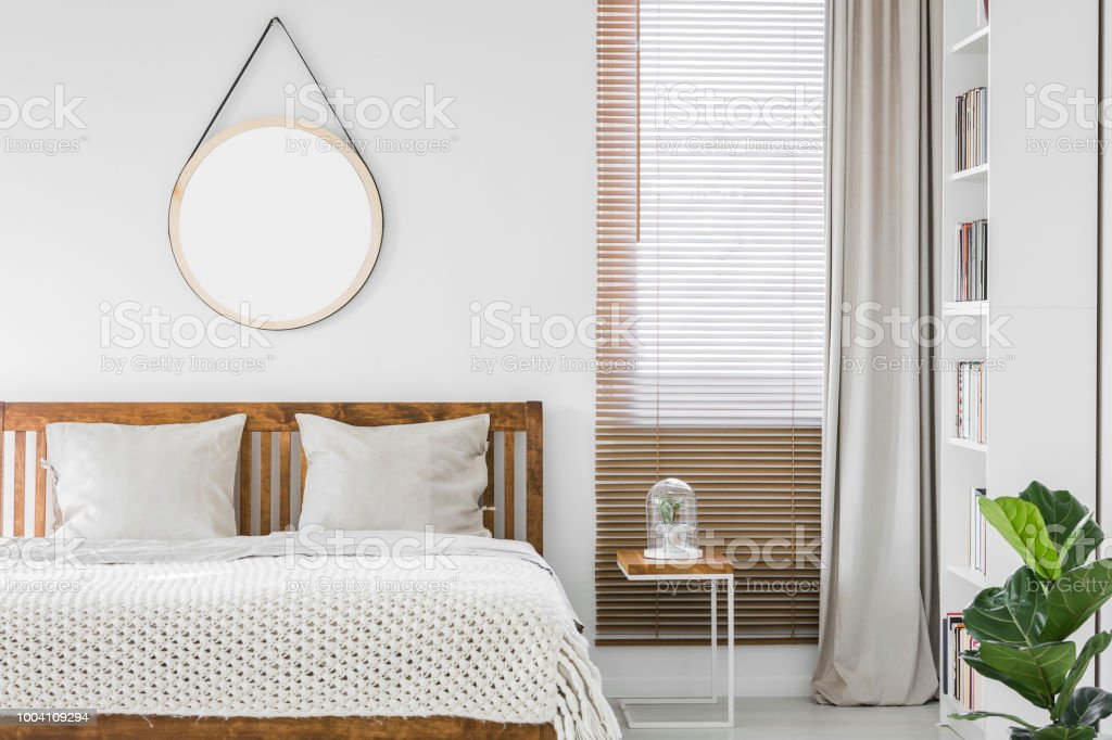 Window With Wooden Blinds And Light Grey Curtain In White Bedroom ...