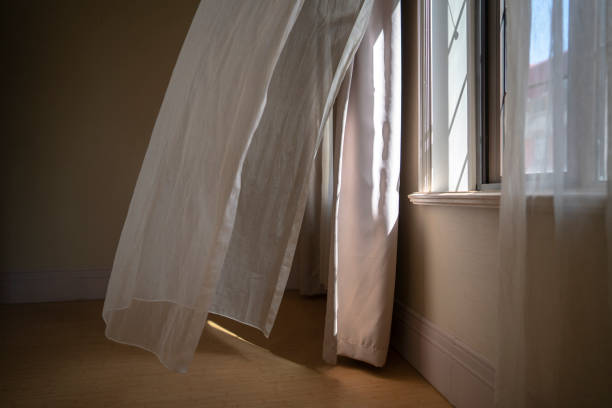 window,curtain and sunlight in morning stock photo