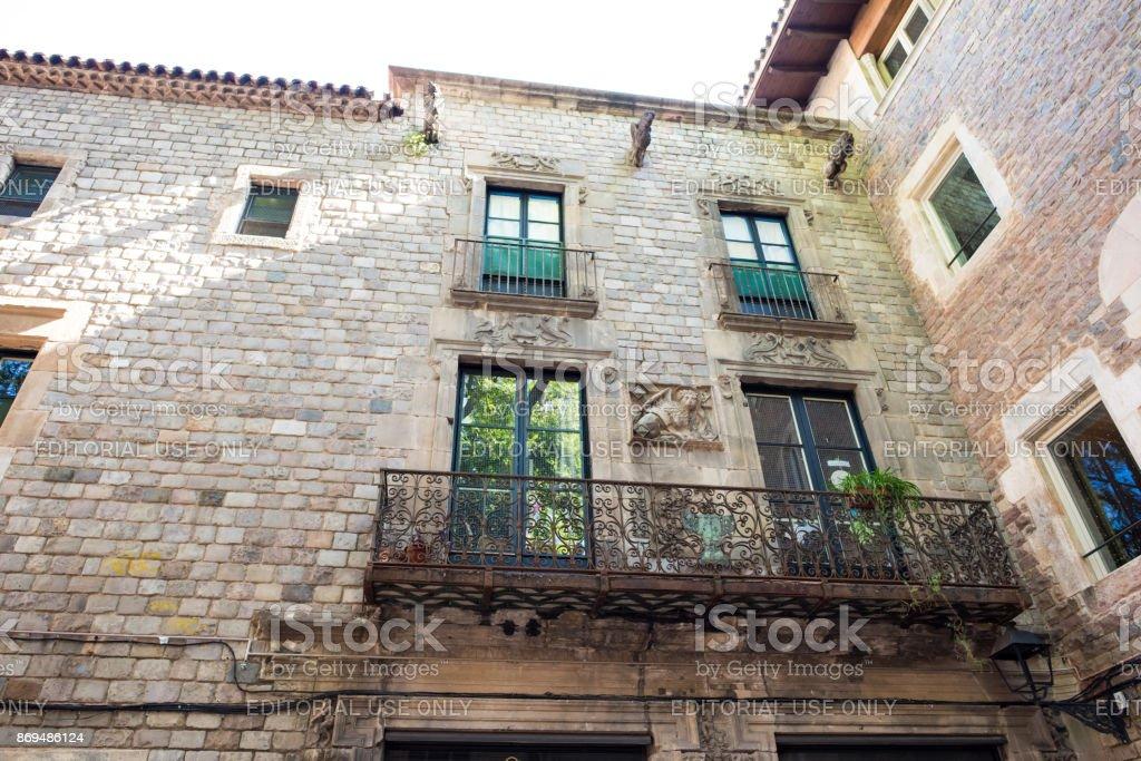 Windows above in Felip Neri Plaza in Barcelona stock photo