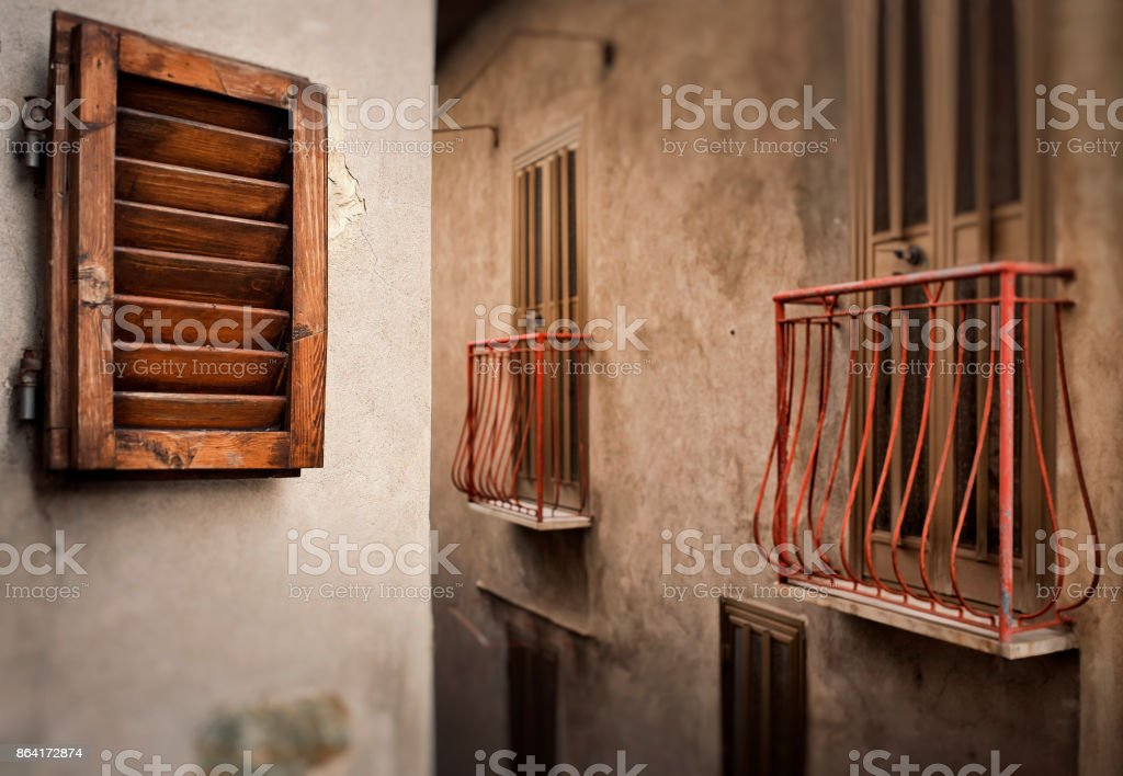 Windows and balconies, rustic style royalty-free stock photo