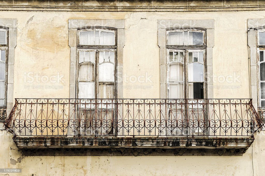 Windows and balcony of old abandoned building royalty-free stock photo