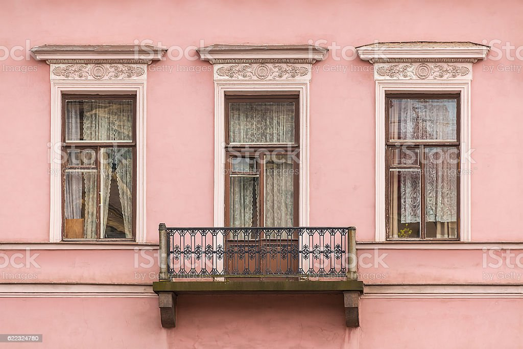 Windows and balcony on facade of apartment building stock photo
