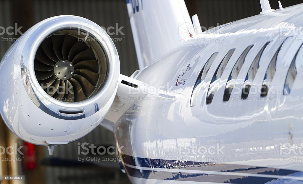 Windows and Engine of Corporate Jet stock photo