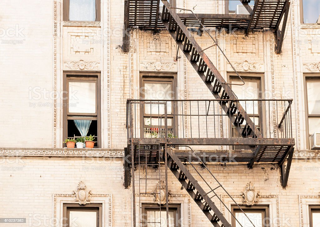 NYC Windows and Fire Esacpe Architecture in Historic Residential Building stock photo