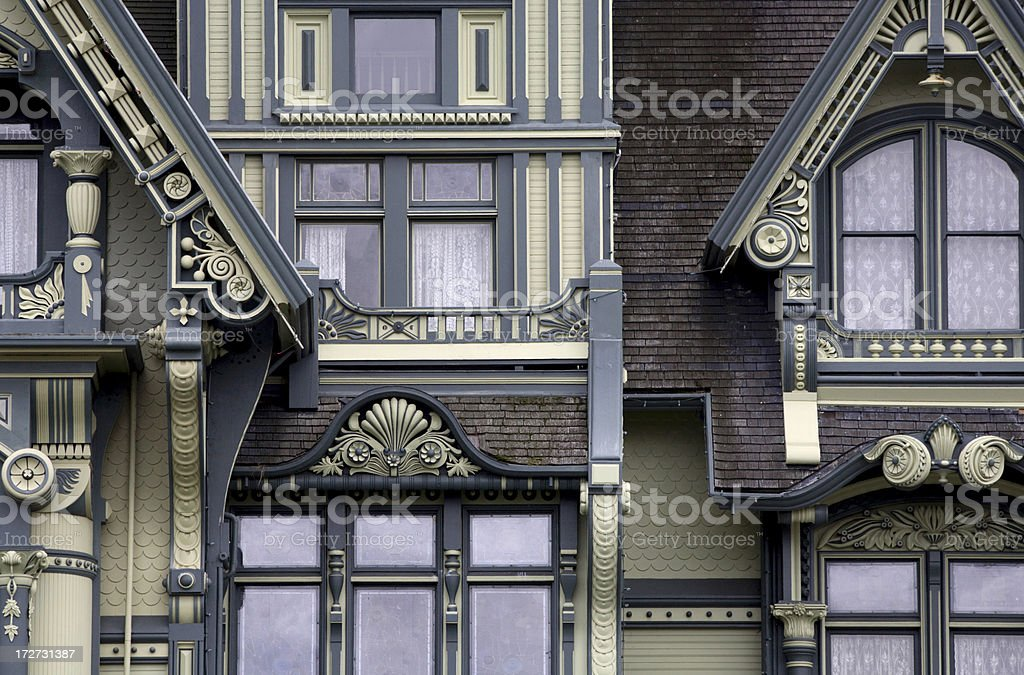 Windows and trim of grand Victorian mansion royalty-free stock photo