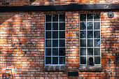 Windows at an old industrial building in brick stone