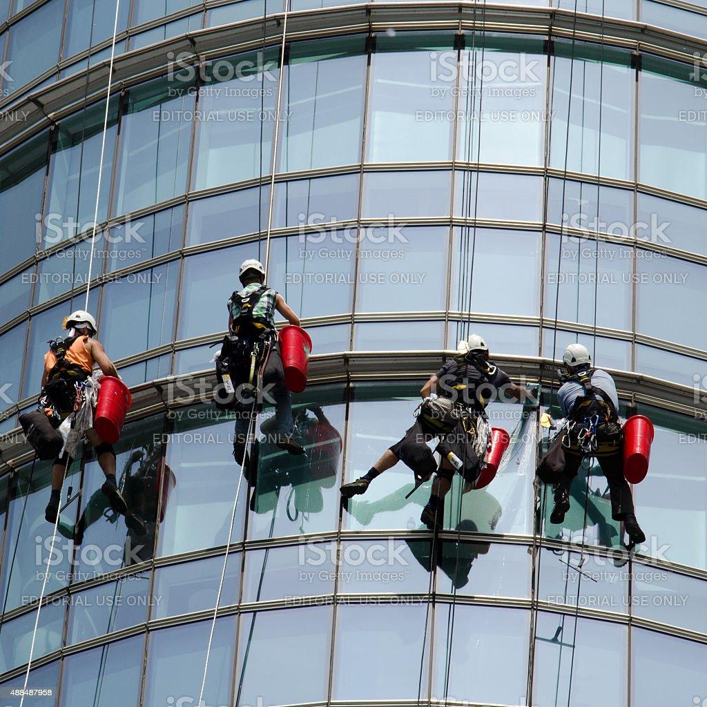 Windows cleaner in Milan stock photo