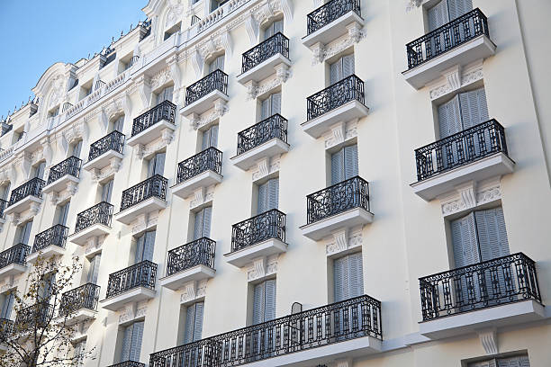 Windows facade of an apartment building Madrid, Spain stock photo